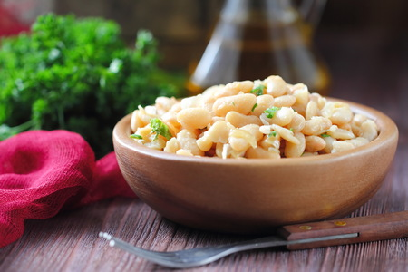haricot: Boiled white haricot with fried onion and fresh parsley Stock Photo
