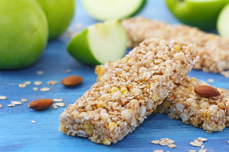 roughage: Healthy food. Cereal bars of granola with apples, nuts and honey Stock Photo