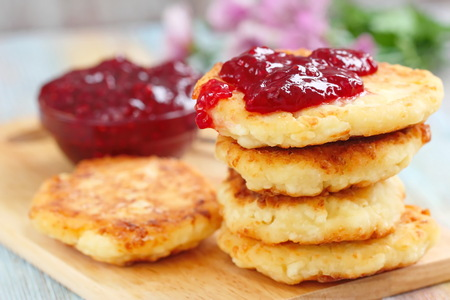 Cottage cheese pancakes with raspberry jam for breakfast