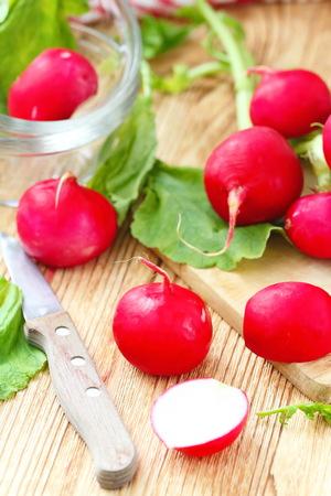 Fresh sliced radishes on wooden table