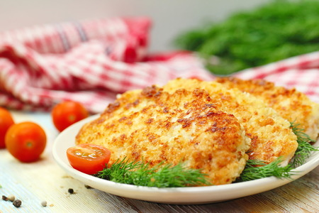 Fried chicken fillet in bread crumb with vegetables Stock Photo