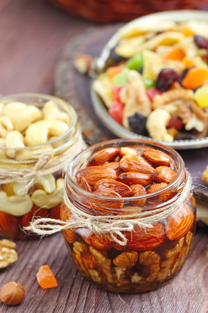 Dried fruit and nuts with honey in glass Stock Photo