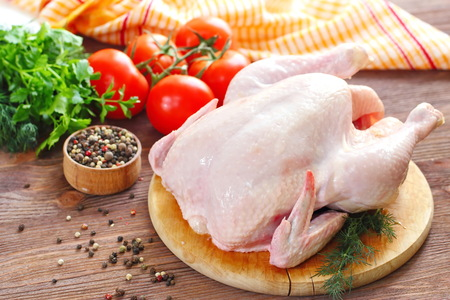 Uncooked chicken with vegetables and spices before cooking