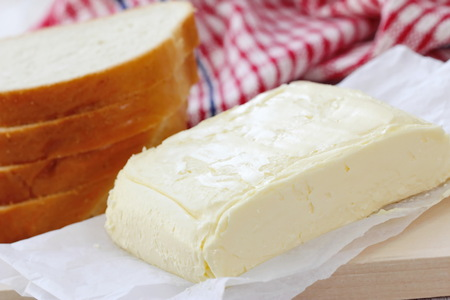 butterfat: Piece of fresh butter on the wooden table
