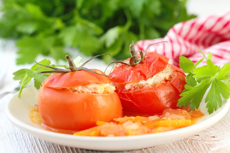 Baked tomatoes stuffed with meat, rice and vegetables