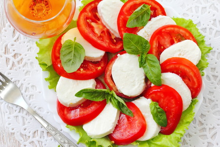 Salad caprese made of tomato, mozzarella and basil Stock Photo