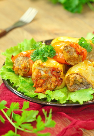 Baked peppers stuffed with meat, rice and vegetables served for dinner Stock Photo
