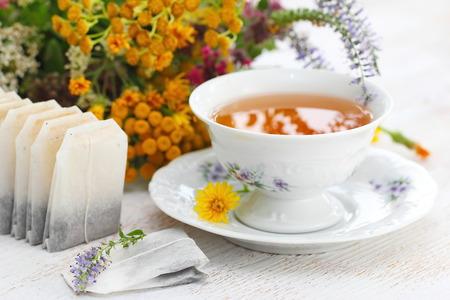 Cup of herbal tea and flowers in summertime Lizenzfreie Bilder