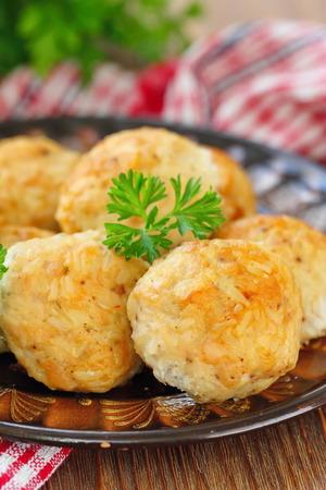 Homemade chicken meatballs with rice and vegetables served with fresh greens Lizenzfreie Bilder