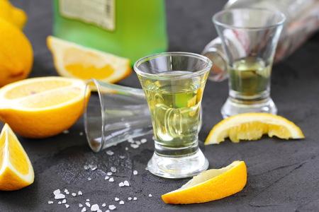 Alcohol lemon drink in glass and fresh fruit Lizenzfreie Bilder
