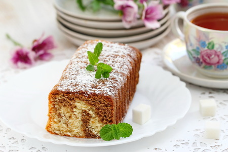 desk: Homemade marble cake on the plate served for teatime Stock Photo