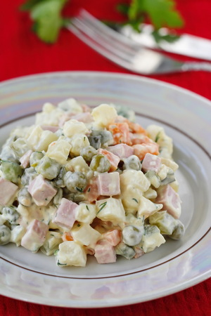 National cuisine. Russian traditional salad Olivier served for New Year party.