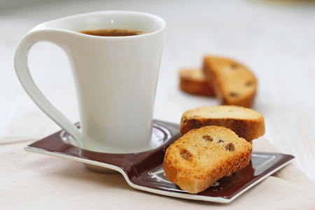 Homemade cookies biscotti with dry berries and cup of coffee