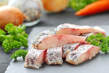 Raw fish on the table prepared for cooking