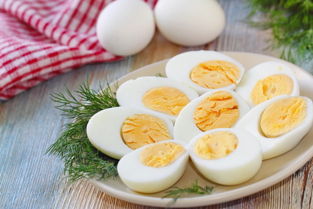 Cooking a salad with boiled eggs. Healthy food Standard-Bild