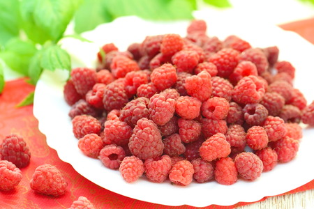Fresh ripe raspberry on natural background in rustic style