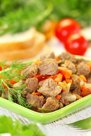 Homemade fried meat with spice and vegetables Standard-Bild
