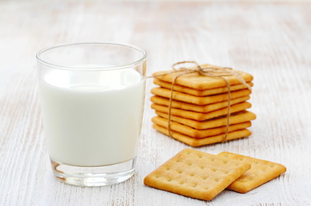 Sweet cookies and fresh milk in a glass
