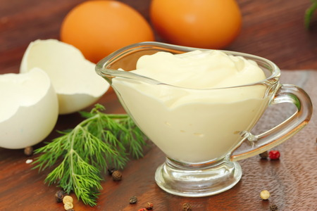 Mayonnaise sauce in a bowl with ingredients