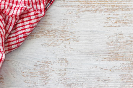 Wooden kitchen background of white color with red towel Standard-Bild