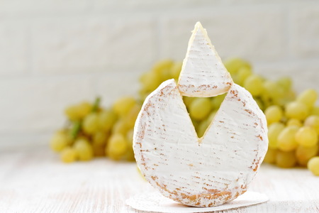 Brie type of cheese and grape. Camembert cheese. National cuisine