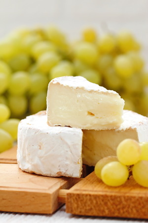 Brie type of cheese and grape. Camembert cheese. National cuisine 写真素材 - 101524533