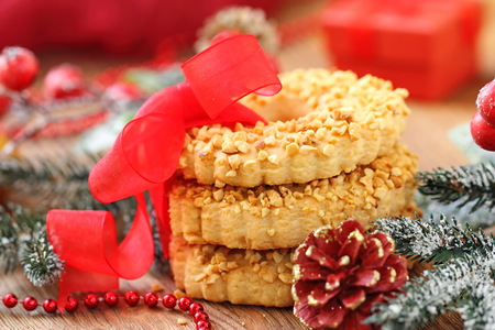Sweet christmas cookies with nuts and festive decoration