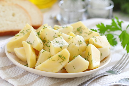 Boiled potatoes with fresh greens and oil ready for eat Stock fotó