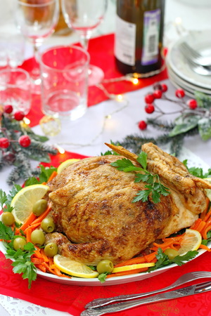 Celebratory food. Baked chicken stuffed with ham and mushrums. Delicious stuffed chicken served for festive dinner on a table.