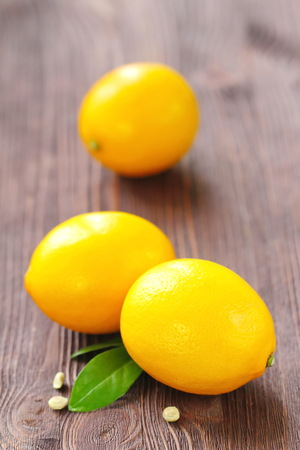 Fresh ripe lemons on the wooden table. Healthy food
