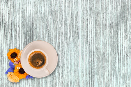 Cup of morning coffee and fresh flowers on light wooden table. Top view. Place for text Stock fotó