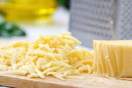 Grated cheese on the table prepared for cooking