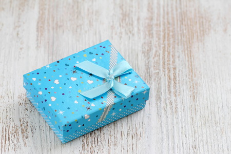 Gift box on wooden table. Festive concept. Decoration for holiday Stock Photo