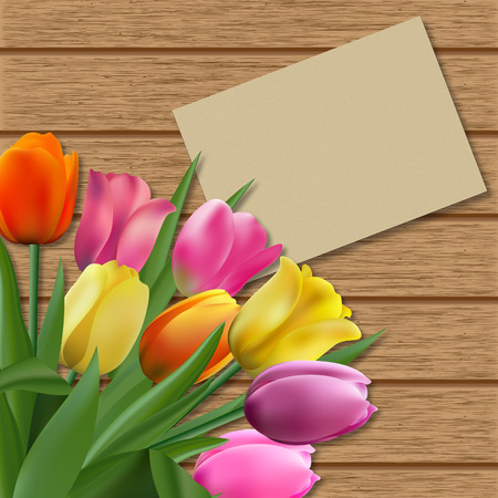 Tulips on brown wooden background and note for text Stockfoto