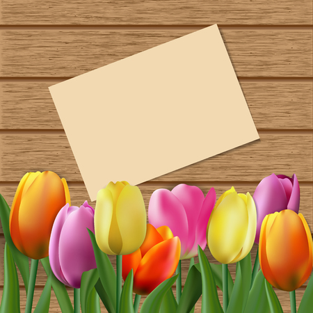 Tulips on brown wooden background with place for text