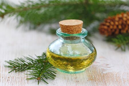 Essential aroma oil witn needle smell in glass bottle