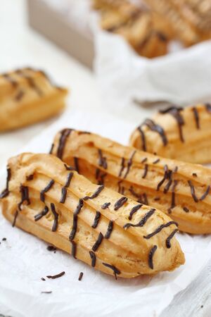 Traditional french eclairs with cream and chocolate ready for eat Stock fotó