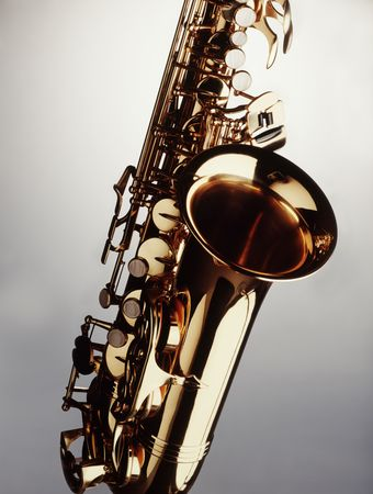 musical instrument: Saxophone closeup against neutral background Stock Photo