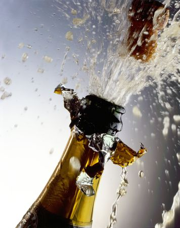 popping the cork: Champagne Bottle with cork shooting Stock Photo