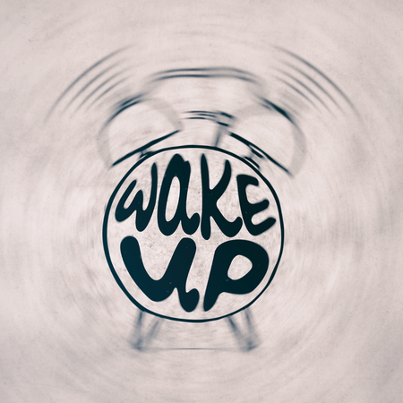 Hand draw Alarm clock illustration with lettering about wake up. Waking up reminder in sketched alarm clock. Фото со стока