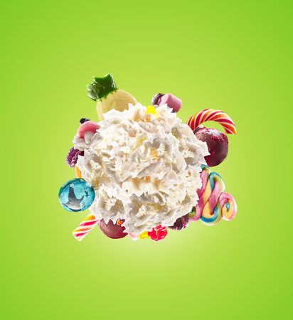 Whipped round cream with colored sweets, jelly and candies isolated. Sweet life concept. Sweet dessert - whipped milk cream concept with treat, kid cartoon colorful cream, white whipped cream with colored sweets. Monster freak milk shake whip cream Stock Photo