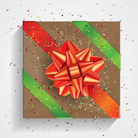 Brown gift box with big red bow and red and green ribbons isolated on white background. Christmas and Birthday package, selebration realistic gift box, top view Stockfoto