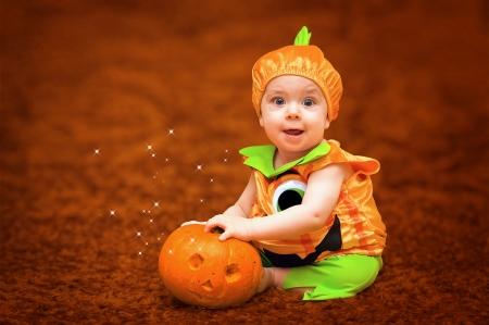 Halloween child with pumpkin