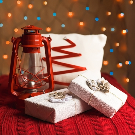 Christmas lantern with presents, ornaments and pillow photo