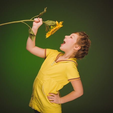 Girl with sunflower photo