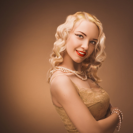 costume jewelry: Retro portrait of a beautiful blonde woman