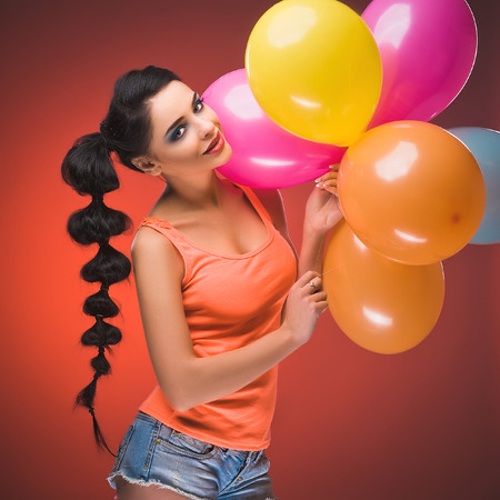 Girl with balloons in studio photo