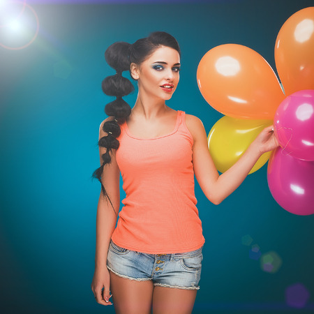 Girl with balloons in studio Stock Photo