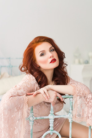 redhead lingerie: Romantic red-haired woman in gentle dress in bright room
