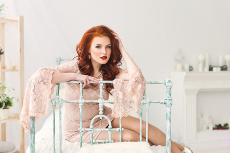 ginger hair: Romantic red-haired woman in gentle dress in bright room
